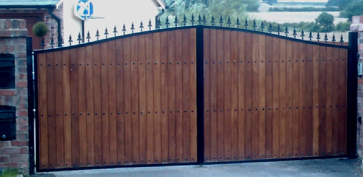 Wooden clad iron gates automation steel framed timber